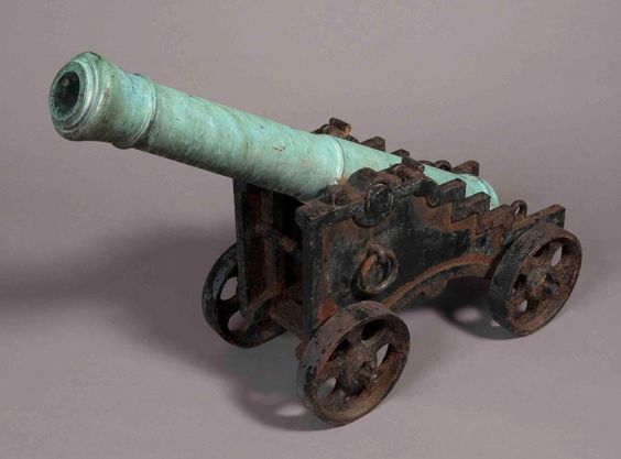 """18th Century Bronze French Upper Deck Muzzle Loading One Pound Cannon """"  Inscribed 'Taken By Earl Howe 1 June 1794' and being mounted on a later 19th Century iron carriage."""