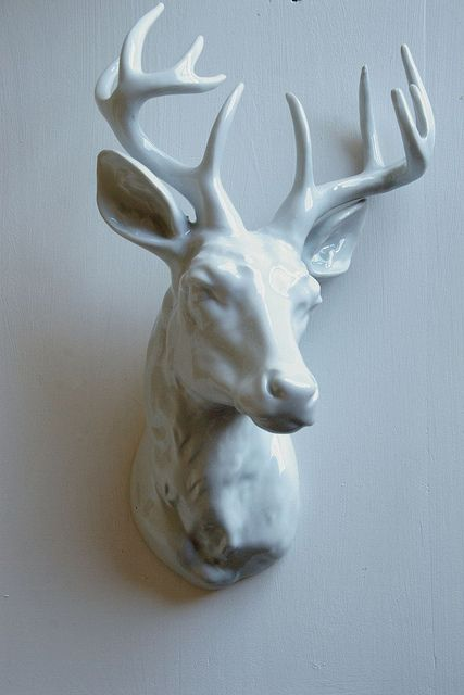 I hate real deer heads, but ones that are ceramic, cardboard, etc are so cool!