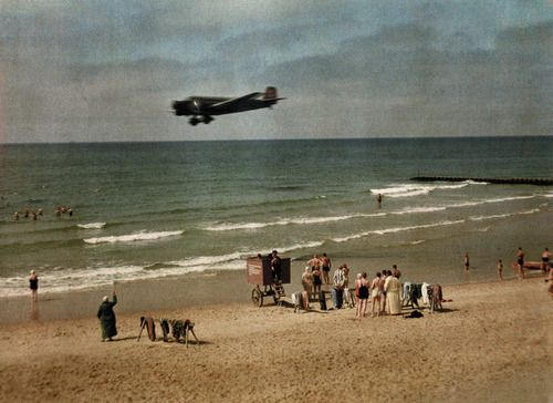People on the beach in Germany as a plane flies overhead, 1928. Photograph by Wilhelm Tobien, National Geographic