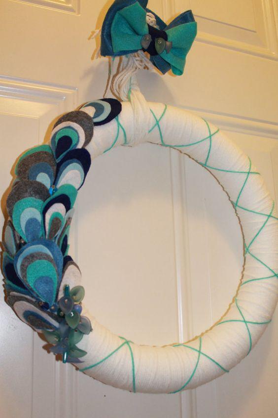 """peacock"" yarn wreath. Maybe in wedding colors?"