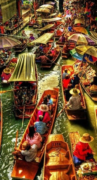 Floating market, Thailand.   If I had to rely on this type of market to get my food, I would probably starve.  ;)