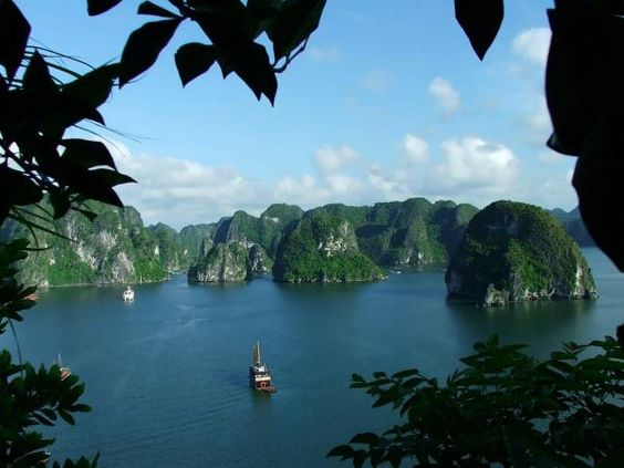 Ha Long Bay is a popular travel destination for its natural wonders, located in Quang Ninh province, Vietnam. The bay features thousands of limestone karsts and isles in various sizes and shapes. Ha Long Bay is a center of a larger zone which includes Bái Tử Long bay to the northeast, and Cát Bà islands to the southwest. These larger zones share similar geological, geographical, geomorphological, climate, and cultural characters.