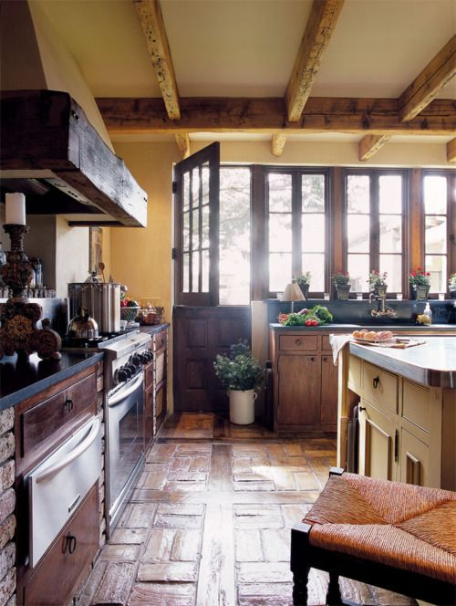 stone floor, kitchen.  Wood beams, country sink...yeah I would take all of that!
