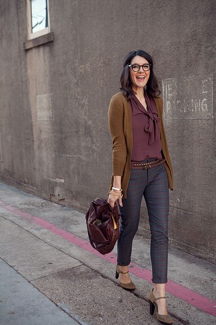 Pretty tie-bow plum top with brown open faced cardigan and dark gray ankle pants and heels.: