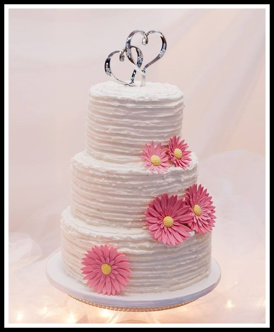 3 Tier Vintage ruffle buttercream cake with sugar gerber daisies.