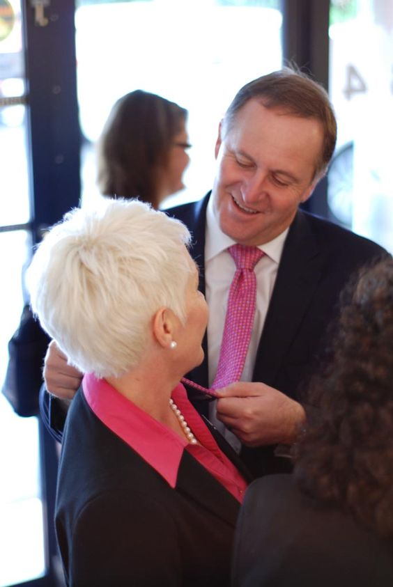 Prime Minister John Key compares the colour of his tie to Principal Catherine Wouters's uniform.