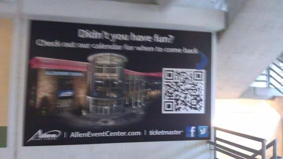 An airport advertisement has a large QR code.