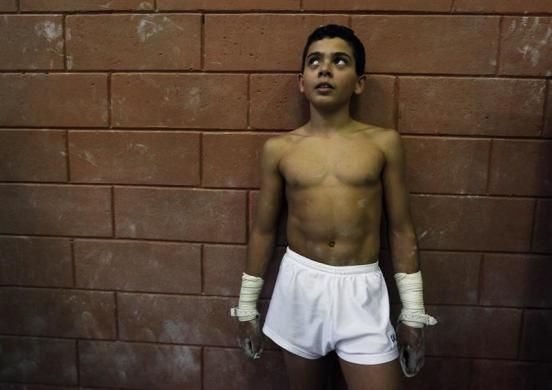 Gabriel Faria Barbosa, 13, stands during practice session at SERC Santa Maria gymnasium's center in Sao Caetano do Sul, near Sao Paulo August 10, 2012. Brazilian gymnast Arthur Zanetti, 22, who won the gold medal in the men's gymnastics rings at the London 2012 Olympic Games, has been training at the center since he was seven years old.   REUTERS/Nacho Doce