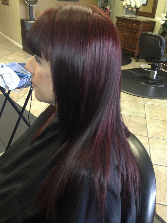 3 of 3, cherry cola color, the fringe is given a blunt cut eyebrow level, a soft natural face frame , with long layers, the cut is finished by applying styling products blow dry and flat iron, detail the cut by, cutting into the corners of the hair to give it a more rounder soft affect, the end result is a beautiful rich cherry cola color with a darker depth and dimension.