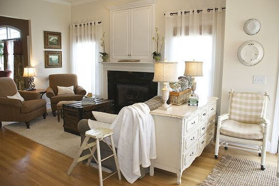 Sitting area (open kitchen/dining/sitting room): 1. old washpans on the wall. 2. old dresser as sofa table. 3. contrast of both painted and stained furniture. {the vintage wren}:: leaving our nest