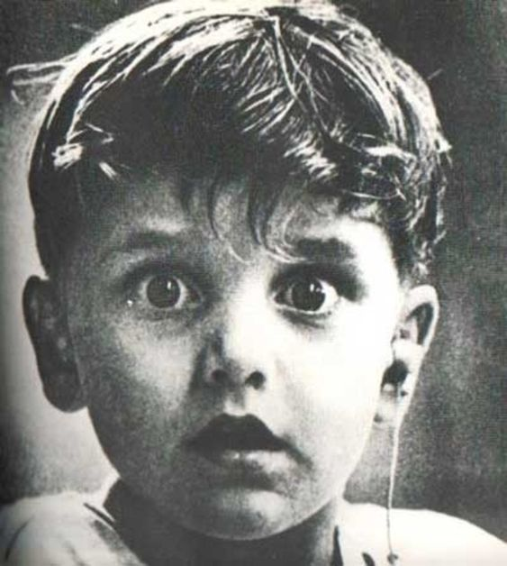 40 Of The Most Powerful Photographs Ever Taken: Harold Whittles HEARS for the FIRST time EVER after a doctor places an earpiece in his left ear. Some powerful photos in this article....