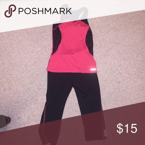Reebok workout set. NWOT Top has a built in bra. Pants are capris. Would fit a lady wearing size S Reebok Pants Leggings