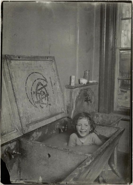 Girl taking a bath in New York City, 1908