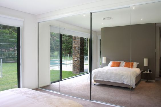 Sliding door wall, one door to ensuite and one to walk in robe and shallow selves in other doors.