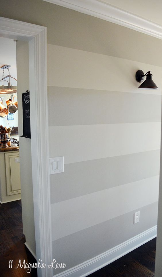 Striped wall in entryway   11 Magnolia Lane. Paint colors: Benjamin Moore revere pewter(darker) & edgecomb grey(lighter). Next to each other on the paint chip.