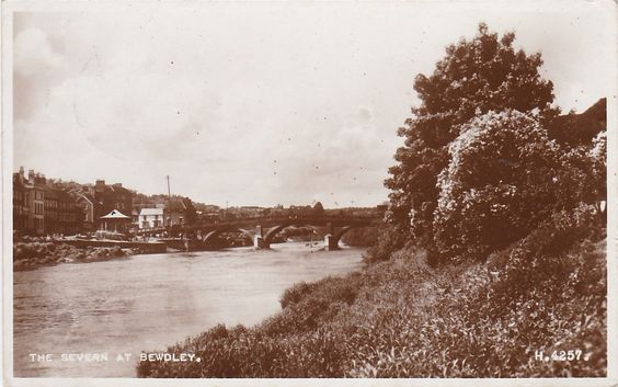 The River Severn, BEWDLEY, Worcestershire Real Photo taken from south of the bridge on the Wribbenhall side of the river. Bewdley town is visible on the left with its riverside bandstand clearly visible.