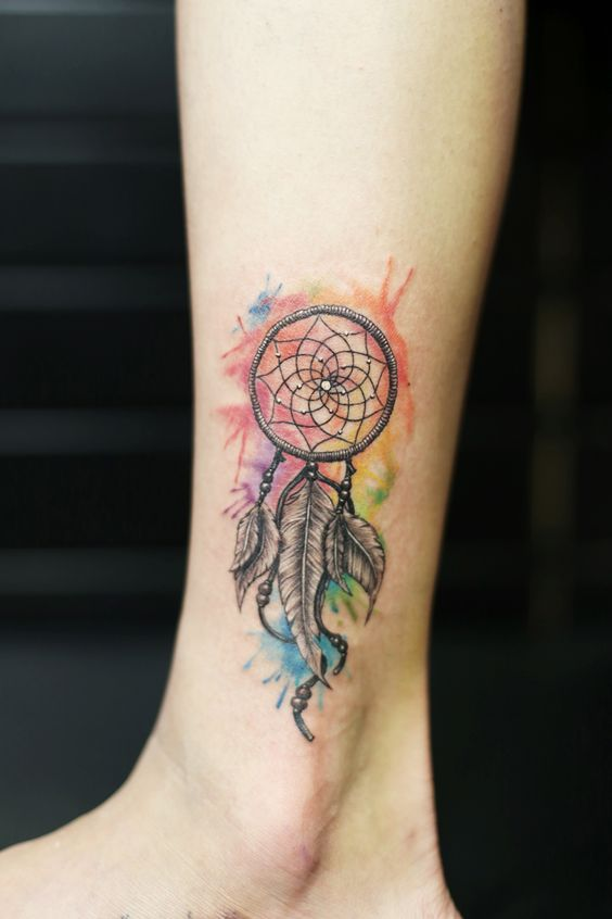 water color dreamcatcher tattoo. inked girl. small size tattoo