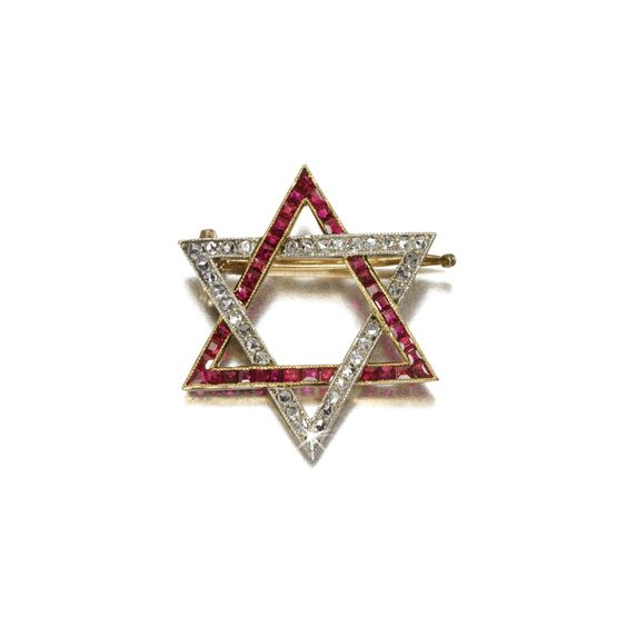 A Fabergé diamond and ruby brooch, workmaster Alfred Thielemann, St Petersburg, circa 1900, formed as a Star of David with interlaced bands of square-cut rubies set in gold and rose-cut diamonds set in platinum, struck with workmaster's initials, scratched inventory number 94766, in A La Vieille Russie case with retailer's card.