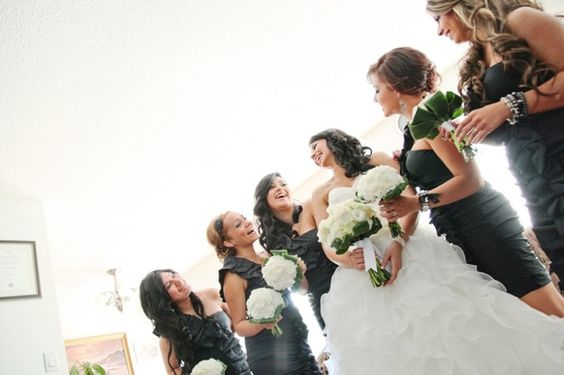 bride and bridesmaids in charcoal gray dresses