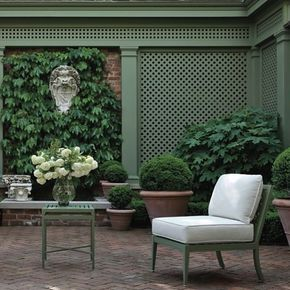 The cedar trellis painted to match its furnishings defines this outdoor living room | Garden and furnishings @mckinnonandharris Landscape architecture Charles Stick Photography @chrislittlephotography See more of this Richmond, VA garden in MILIEU on newsstands now! #MILIEUSpring2017 #Garden #McKinnonAndHarris #Spring #Trellis