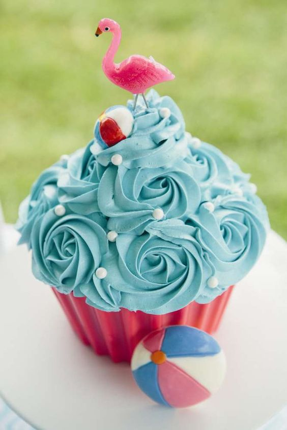Cupcake cake at a flamingo birthday party! See more party ideas at CatchMyParty.com!