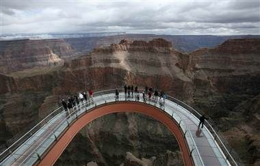 A skywalk extends out over the Grand Canyon in this photo taken Feb. 28, 2012, on the Hualapai Indian Reservation, Ariz. The number of international visitors to the United States rose 10 percent in the first three months of 2012.  (Photo: Robert Galbraith / Reuters file)