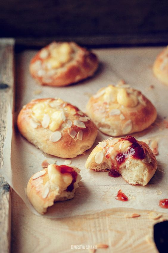 brioches with cream and toasted almonds patissier. Served with strawberry jam.