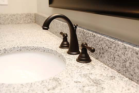 "Basement Bathroom  -Granite Counter Tops  -New Fixtures  -4"" Granite Backsplash"
