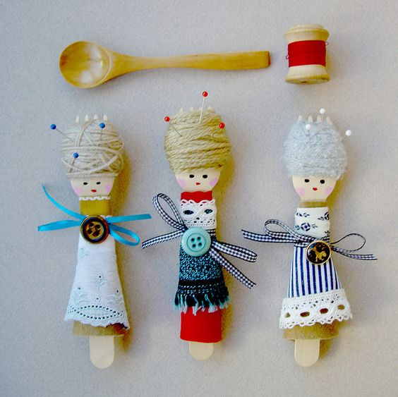 a small wooden fork, wool, felt, fabric and vintage buttons.