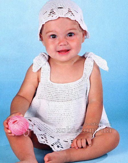white dress and cap (9-12 months).