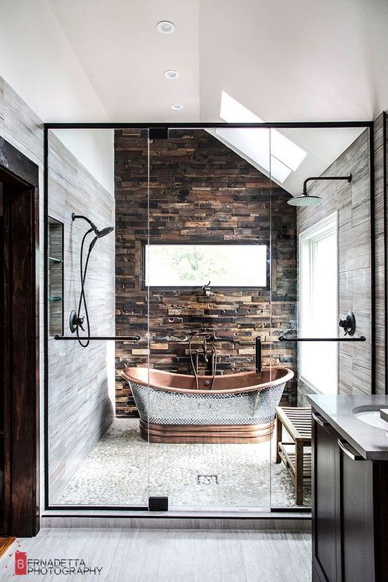 Beautiful detail on the metal surfaces of the tub and love the contrast of polished metal against rough stone.