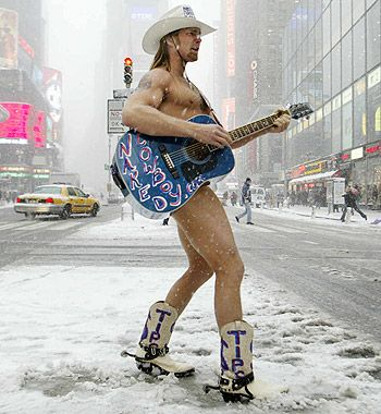 Naked Cowboy in the middle of winter in Time Square with his ...