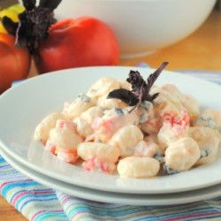 Creamy goat cheese and roasted tomato sauce smothers fresh tomatoes, basil and gnocchi.