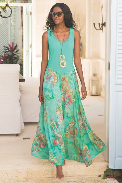 "A balmy beauty, this island-dreams dress skims curves comfortably with a solid knit bodice, then unfurls into tropical flora on a skirt of lagoon-hued woven challis. With a flattering dipped waist and maxi-length paneled skirt. Tropical teal. Cotton/spandex knit bodice, rayon challis skirt. Misses 53"" long. Fleur du Jour Dress #2AL83"