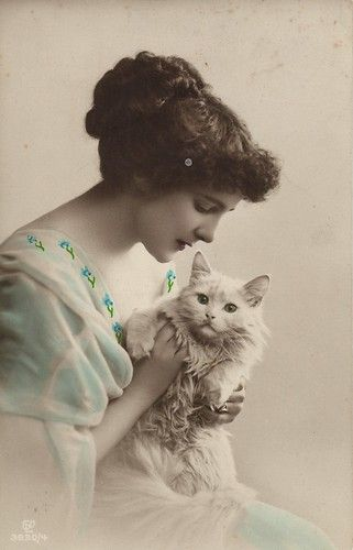 Edwardian lady holding white cat, ca. 1920s: