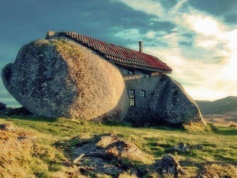 Stone house built from boulder in Fafe Mountains Hillsides of Portugal