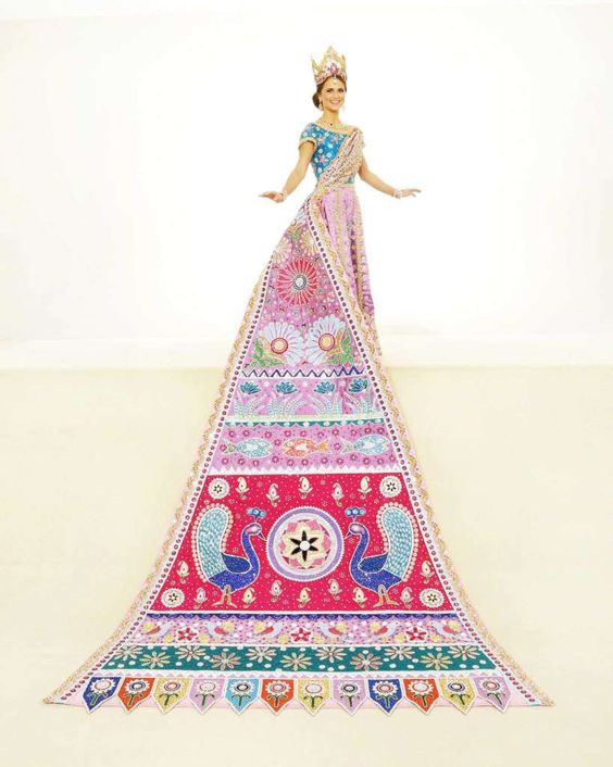 Katherine Basse Farmer, Duchess of Symbolic Artistry: The rich colors and figures of charming Indian folk art are seen on this gown embroidered in gold with pink Austrian stones and violet beading. The train's sun, moon, plants, birds, flowers and fish are adorned with sequins, rhinestones and scalloped gold rope trim. She is the daughter of Mr. and Mrs. Gary Stephen Farmer. Photo: Courtesy Gary Stanko, Billo Smith Photography: