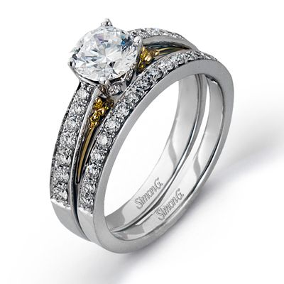 Classy Collection � This gorgeous 18K yellow and white engagement ring and band is comprised of .50ctw round white Diamonds and .05ctw round yellow Diamonds.  � DR182