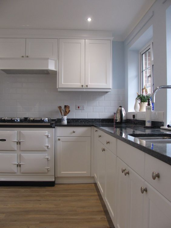 Bespoke kitchen finished in Satin White with Blue Pearl Granite and white Aga
