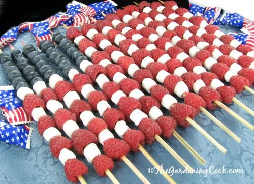 Easy DIY patriotic fruit flag using fruit and marshmallows on skewers. A perfect food idea for your 4th of July party.