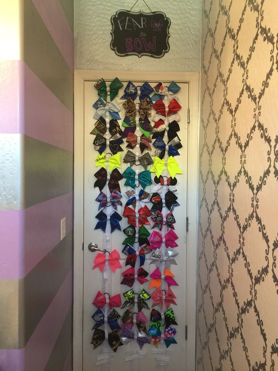 Cheer bow holder with ribbon & Velcro. Easy, functional, organized, and so cute!!