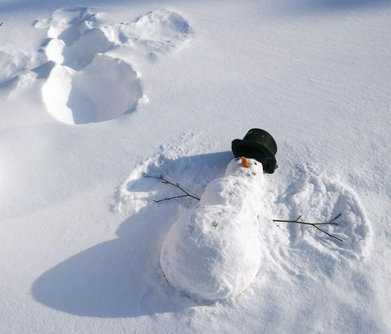 Snowman making a snow angel!