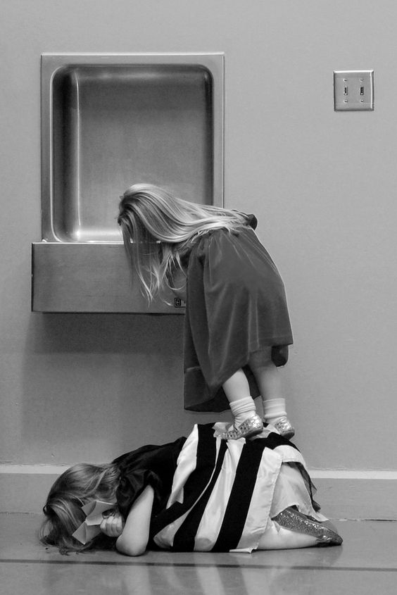 https://flic.kr/p/8ZiGqz   Sisterly Love (BW)   During a recent school performance, during intermission, these two sisters went to go get a drink of water.  The older one promptly got on the ground so the other could use her as a step stool.  So adorable!