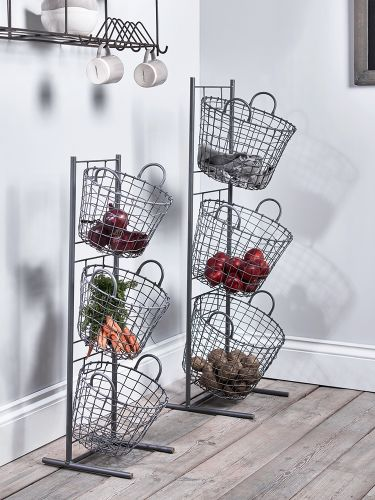 Lifestyle | Stylish Kitchen Storage Solutions - If you have floor space, but no cupboards, a breathable basket can be a good solution. Wire baskets, or more natural rattan baskets, are great for storing long lasting vegetables that don't need to be kept in the fridge. Potatoes and other root vegetables are ideal for this sort of storage, although it is good to store them in the dark to prevent them from sprouting. Basket storage can also be used to store your plastic bag collection