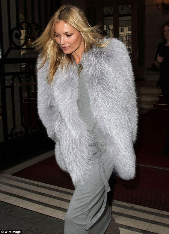 The morning after: Kate Moss looks a little tired as she leaves The Ritz in Paris today