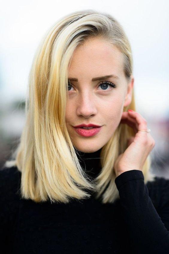 Blunt, blonde straight mid length / shoulder length hair with swept over fringe