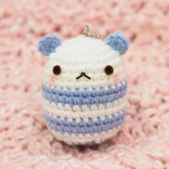 Capsule Bear Amigurumi   A little throwback to when I decide to create something cute but easy to make! ㅇㅅㅇ The pink background is actually a cable beanie that I crocheted for my aunt. My hands are currently full with two orders and lots of tests > ㅅ < Please accept my throwback posts! by whimscree
