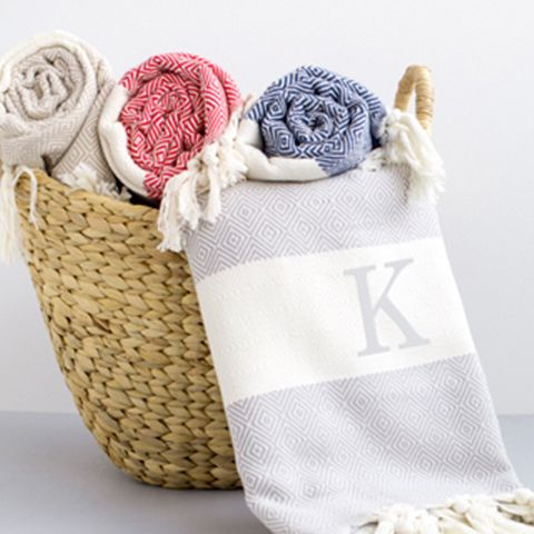 Give a unique gift to your bridesmaids that'll stand the test of time! Personalize a chic Turkish throw blanket with each girl's initials. | MyWeddingFavors.com | @MyWeddingFavors