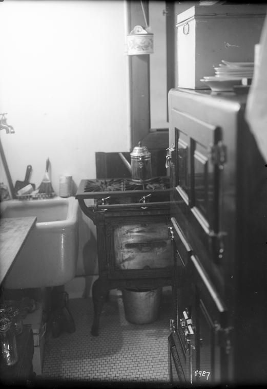 kitchen with stove sink ice box coffee pot tenement