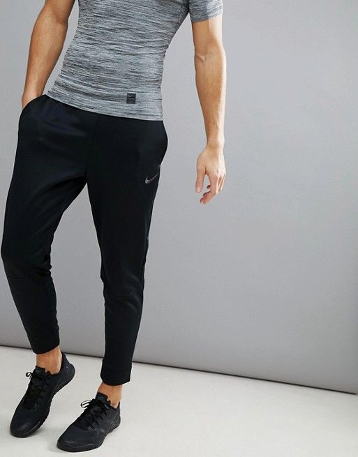 Nike Training therma tapered joggers in black 800193 010